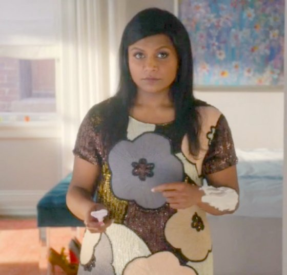 Mindy Kaling shaving her arms